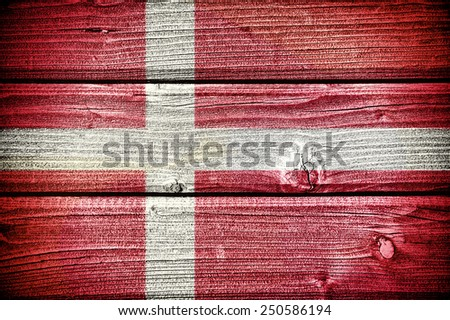 Flag of Denmark painted on old grungy wooden  background