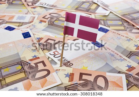 Flag of Denmark sticking in european banknotes.(series) - stock photo