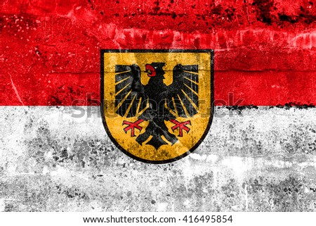 Flag of Dortmund, painted on dirty wall. Vintage and old look. - stock photo