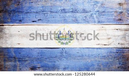 Flag of El Salvador painted on grungy wood plank background - stock photo