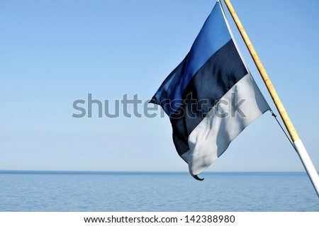 Flag of Estonia flying in the wind - stock photo