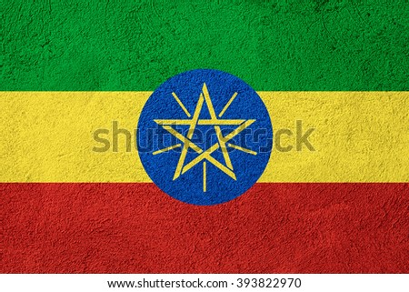 flag of Ethiopia or Ethiopian banner on rough pattern background