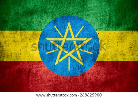 flag of Ethiopia or Ethiopian banner on rough pattern texture background - stock photo