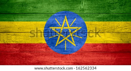 flag of Ethiopia or Ethiopian banner on wooden background