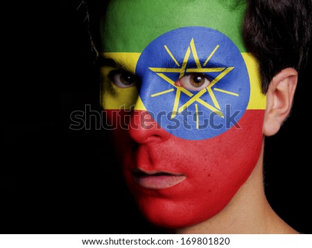 Flag of Ethiopia Painted on a Face of a Young Man