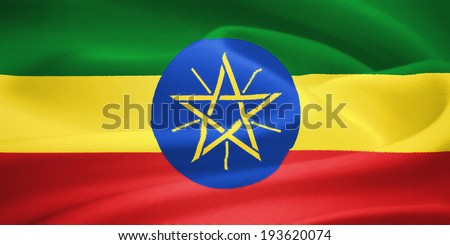 Flag of Ethiopia waving in the wind. Silk texture pattern - stock photo