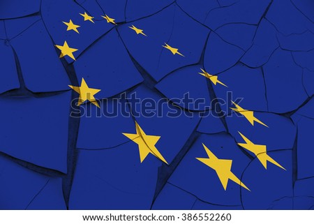 Flag of EU and a circle of 12 gold (yellow) stars on a cracked wall. A symbol of instability in the European Union after several serious problems arise i.e. sovereign debt crisis, inflation rate, etc. - stock photo