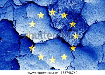 flag of EU painted on cracked wall - stock photo