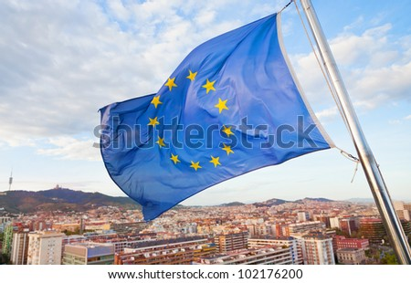 Flag of Europe under Barcelona city - stock photo