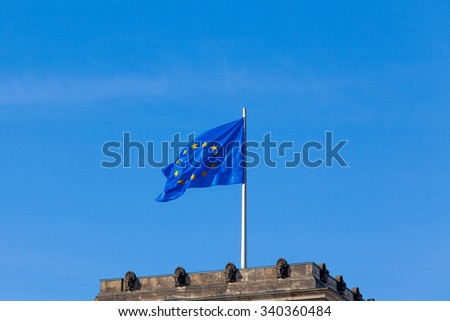 Flag of European Union.  EU Flag towards blue sky - stock photo