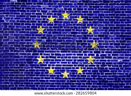 Flag of European Union painted on brick wall, background texture - stock photo