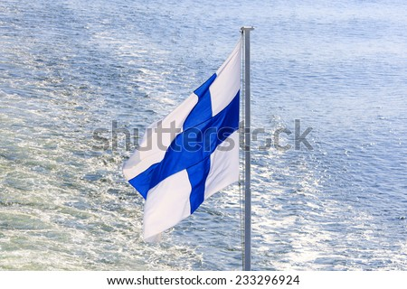 Flag of Finland on cruise ship on Baltic Sea. - stock photo