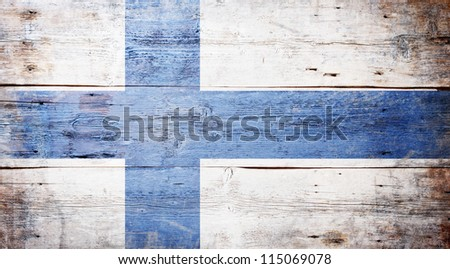 Flag of Finland painted on grungy wood plank background - stock photo