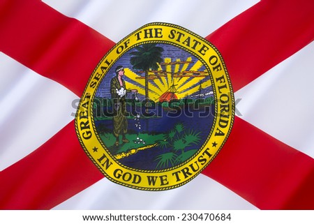 Flag of Florida - United States of America. The flag has a red saltire (St. Andrews Cross) on a white background, with the state seal in the center. The design has been in use since May 21st 1985. - stock photo