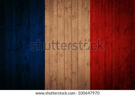 flag of France on wooden background - stock photo