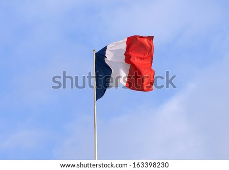 Flag of France over a blue sky - stock photo