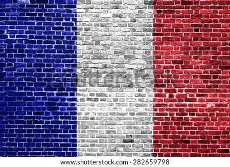 Flag of France painted on brick wall, background texture