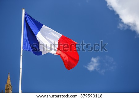 Flag of France, waving in the wind, on the sky  - stock photo