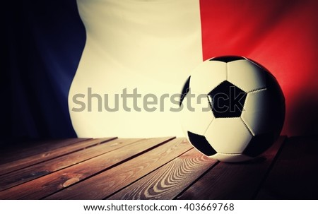 Flag of France with football on wooden boards as the background. Vintage Style. - stock photo