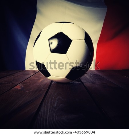 Flag of France with football on wooden boards as the background. Vintage Style. MANY OTHER PHOTOS FROM THIS SERIES IN MY PORTFOLIO. - stock photo