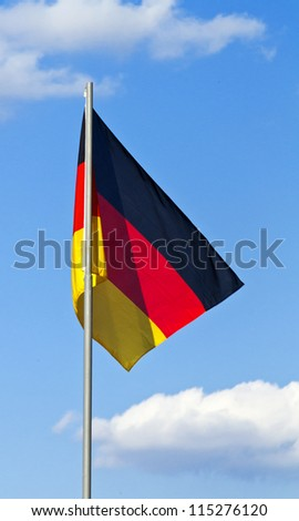 Flag of Germany against the blue sky - stock photo