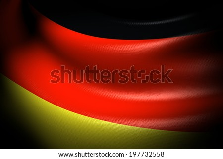 Flag of Germany in the dark with brightness spot - stock photo