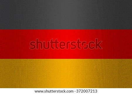 Flag of Germany on a stone wall background.