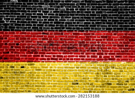 Flag of Germany painted on brick wall - stock photo