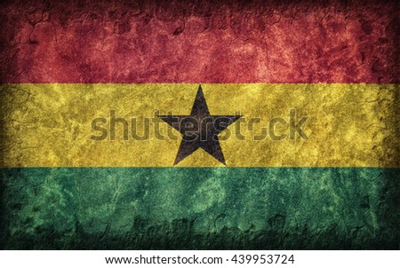Flag of Ghana painted onto a rough wall - stock photo