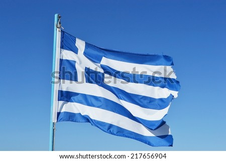 Flag of Greece on blue sky background. - stock photo