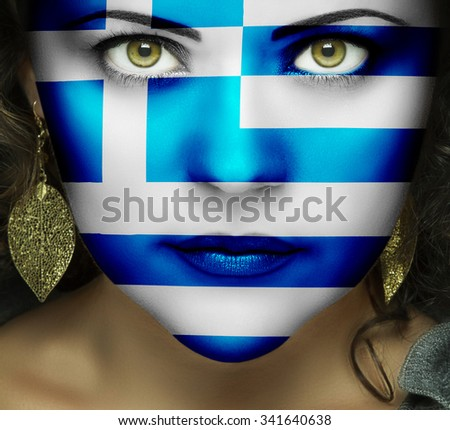 Flag of Greece on face of woman with green eyes - stock photo