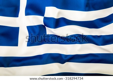 Flag of Greece waving in the wind. - stock photo