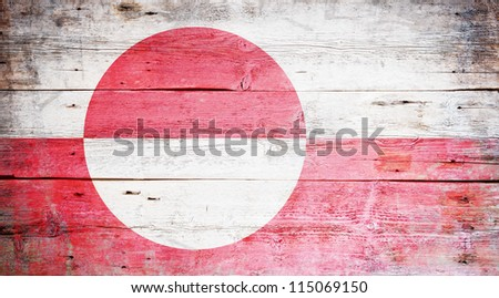 Flag of Greenland painted on grungy wood plank background - stock photo