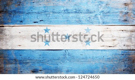 Flag of Honduras painted on grungy wood plank background - stock photo