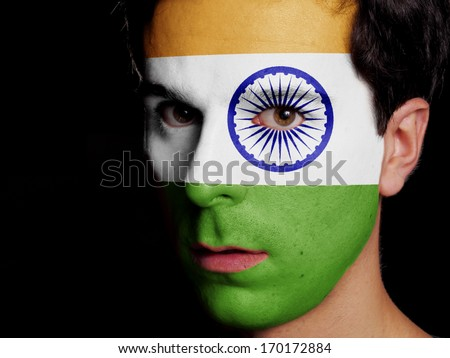 Flag of India Painted on a Face of a Young Man - stock photo