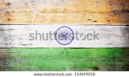Flag of India painted on grungy wood plank background - stock photo