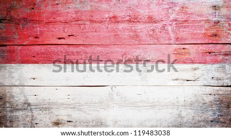Flag of Indonesia painted on grungy wood plank background - stock photo
