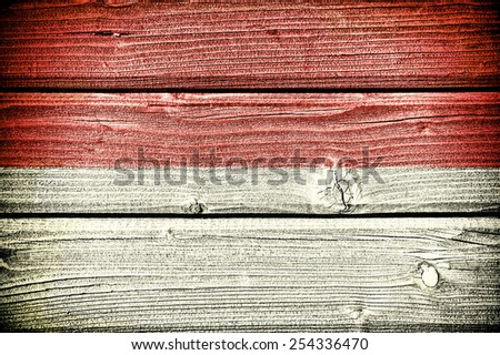 flag of Indonesia painted on old grungy wooden  background - stock photo