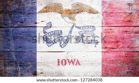 Flag of Iowa painted on grungy wooden background - stock photo