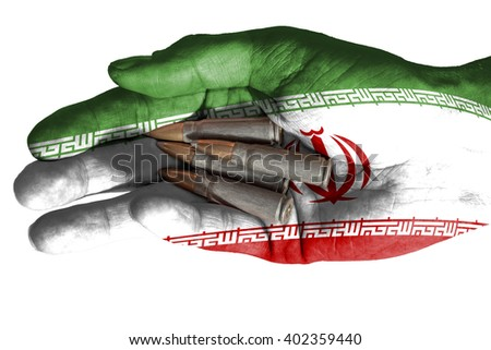 Flag of Iran overlaid the hand of an adult man holding four bullets. Conceptual image for war, violence, conflicts. Image isolated on white background - stock photo