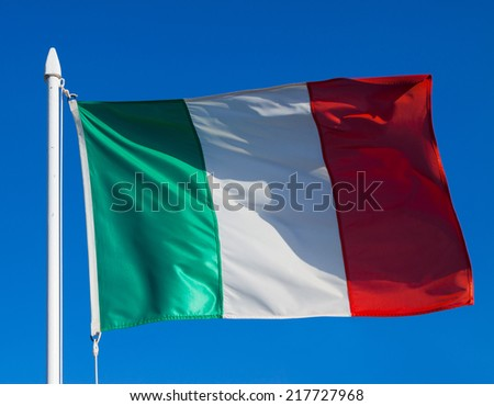 Flag of Italy against blue sky during wind
