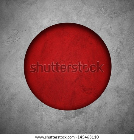 Flag of Japan. Holes cut on white grunge wall to show red wall behind to form flag of Japan - stock photo