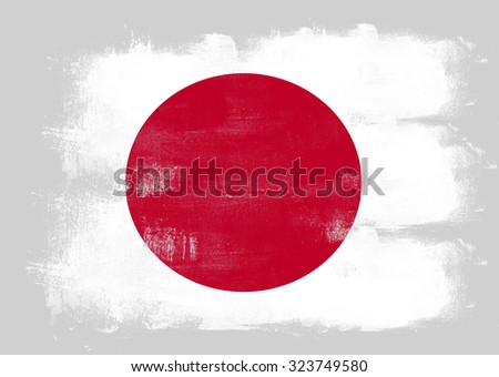 Flag of Japan painted with brush on solid background,