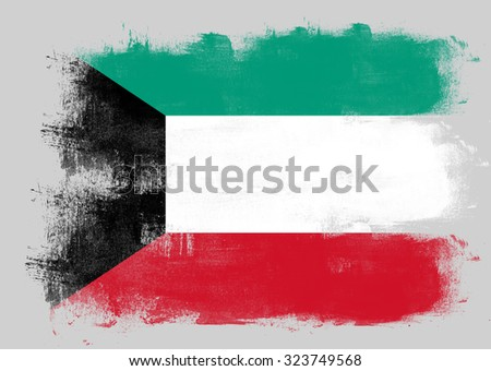 Flag of Kuwait painted with brush on solid background, - stock photo