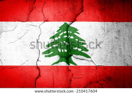 flag of Lebanon painted on cracked wall - stock photo