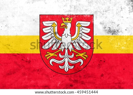 Flag of Lesser Poland Voivodeship with Coat of Arms, Poland, with a vintage and old look - stock photo