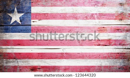 Flag of Liberia painted on grungy wood plank background - stock photo