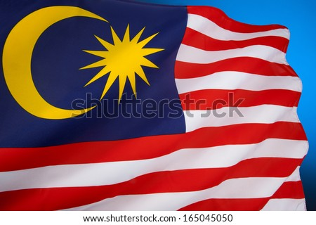 Flag of Malaysia or Jalur Gemilang - comprises a field of 14 alternating red and white stripes and a blue canton bearing a crescent and a 14-point star known as the Bintang Persekutuan (Federal Star) - stock photo