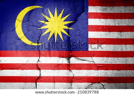 flag of Malaysia painted on cracked wall - stock photo