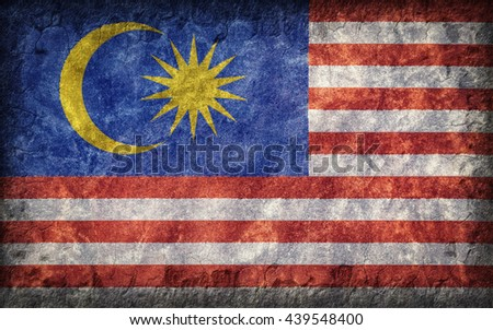 Flag of Malaysia painted onto a rough wall